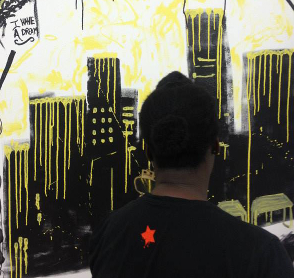 Painting the walls of the pop up shop during the 90 min art battle title=SomewhereTo_ Restore pop up wrap party